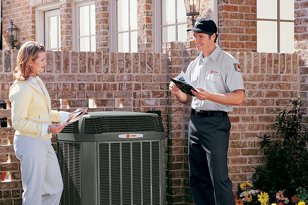 Heat Pump Products - Technician with Woman