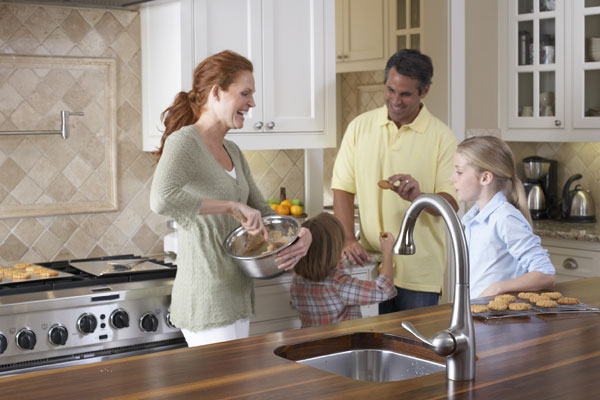 Tankless Water Heaters - Family Cooking in the Kitchen